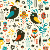 Colorful seamless pattern with birds and flowers. Stock Images