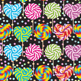 Colorful seamless pattern, candy lollipops, spiral candy cane. Candy on stick with twisted design pastel colors polka dot black ba Stock Photos