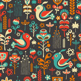 Colorful seamless pattern with flying birds and flowers. Stock Photos