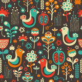 Colorful seamless pattern with funny birds and flowers. Royalty Free Stock Image