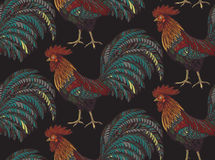Colorful seamless pattern with hand drawn fiery roosters. In doodle ornate style. Beautiful vector endless background. Symbol of the new year Royalty Free Stock Images