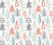Seamless pattern with ornate Christmas trees. Royalty Free Stock Images