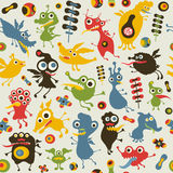 Colorful seamless pattern with happy monsters. Stock Images
