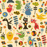 Colorful seamless pattern with happy monsters and flowers. Stock Photography
