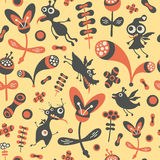 Colorful seamless pattern with happy monsters and flowers. Royalty Free Stock Photo