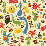 Colorful seamless pattern with happy monsters at the party. Stock Photos