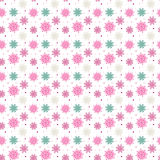 Colorful seamless pattern of many snowflakes on white background. Christmas winter theme for gift wrapping. New Year seamless background for website Royalty Free Stock Images