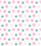 Colorful seamless pattern of many snowflakes on white background. Christmas winter theme for gift wrapping. New Year seamless background for website Stock Photography