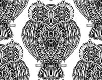 Colorful  seamless pattern with owls on branches Royalty Free Stock Image