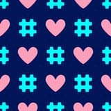 Colorful seamless pattern with repeating hashtags and hearts. stock photo