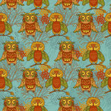 Colorful seamless pattern witn cute doodle owls. Vector illustration Stock Photos