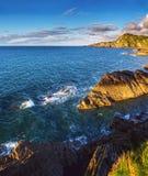 Colorful seascape with rocky coastline Stock Photos