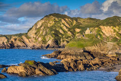 Colorful seascape with rocky coastline Royalty Free Stock Image