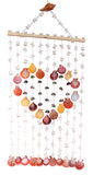 The colorful of seashells curtain. Handicraft seashells curtain on white background Royalty Free Stock Photography