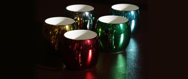 Colorful and seasonal coffee mugs Royalty Free Stock Images