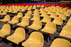 Colorful seats. Row of colorful seats in city park stock images