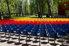 Colorful seats. Row of colorful seats in a city park stock photo