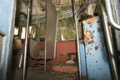 Colorful seats of abandoned trolley car. Chipped and peeling seats and aisle of abandoned trolley car Stock Photo