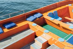 Colorful seats of a cruising sloop Stock Photos
