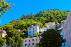 Sintra Colorful Village Buildings, Moorish Castle, Travel Lisbon. Colorful and secular town buildings and, on top of the hill, moorish castle built between the Royalty Free Stock Photos