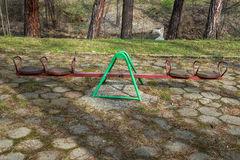 Colorful seesaw in a park Stock Image
