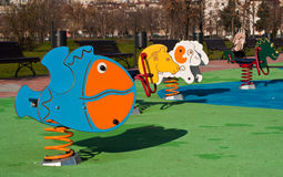 Colorful seesaws. Animal shaped seesaws on a playground in autumn Royalty Free Stock Images
