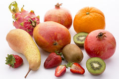 A colorful selection of fruit. Here is a diverse mix of mediterranean, tropical and exotic fruit: one mango, an orange, a mandarine, two kiwis, two pomegranates Royalty Free Stock Image