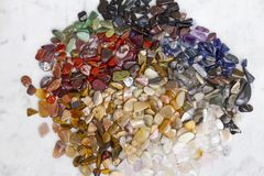 Colorful semi-precious stones on the marble background, texture. royalty free stock photography