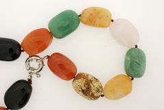 Colorful semiprecious stone necklace. Closeup of a colorful semiprecious stone necklace Stock Images