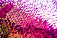 Colorful sequined texture. Glittering festive sequin color, shining holiday background. For sites, flyers, package for Valentine. 's Day, Christmas or stock images