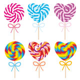Colorful Set candy lollipops with bow, spiral candy cane. Candy on stick with twisted design on white background. Vector Stock Images
