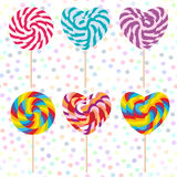 Colorful Set candy lollipops, spiral candy cane. Candy on stick with twisted design on white abstract geometric retro polka dot ba Royalty Free Stock Photography