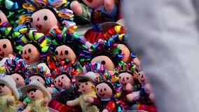 Colorful set of handmade dolls. Tepotzotlan, Mexico-CIRCA June 2017: Colorful set of handmade dolls. Mexico is widely known by its beautiful regional traditions stock footage