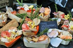 A colorful set of mushrooms in small baskets in a market in London Stock Photography
