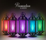 Colorful Set of Ramadan Lanterns or Fanous with Lights and Ramadan Kareem Greetings Stock Photo