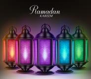 Colorful Set of Ramadan Lanterns or Fanous with Lights and Ramadan Kareem Greetings Stock Photo