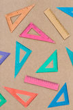 Colorful set squares on brown paper Royalty Free Stock Photo