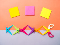 Colorful set of zigzag  scissors and sticky note on pastel backg Royalty Free Stock Images