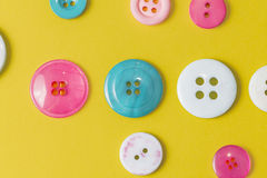 Colorful sewing button on yellow Stock Photography
