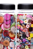 Colorful sewing buttons. In a bottle on white background Stock Photography
