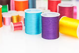 Colorful sewing thread. On white Stock Image