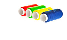 Colorful sewing threads Stock Photos