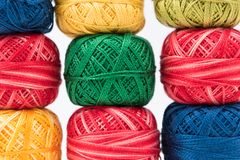 Colorful sewing threads as background or wallpaper Stock Image