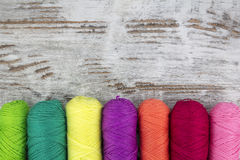 Colorful sewing threads background stock images