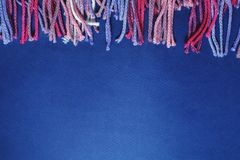 Colorful sewing threads on blue Royalty Free Stock Photos