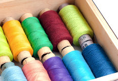 Colorful sewing threads in a box. Colorful sewing threads  box background palette Stock Photo