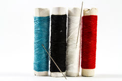 Colorful Sewing threads with needle Royalty Free Stock Image
