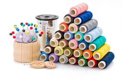 Colorful sewing threads and other sewing accessories Royalty Free Stock Image