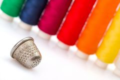 Colorful sewing threads and thimble Royalty Free Stock Image