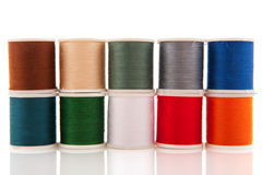 Colorful sewing threads on white spools Royalty Free Stock Photos